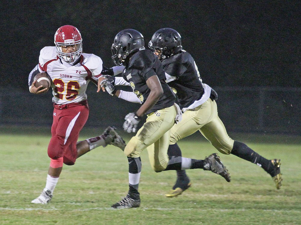 Southern Guilford fullback Romello Herbin runs for a short gain against Western Guilford players. Photo by Joe Daniels