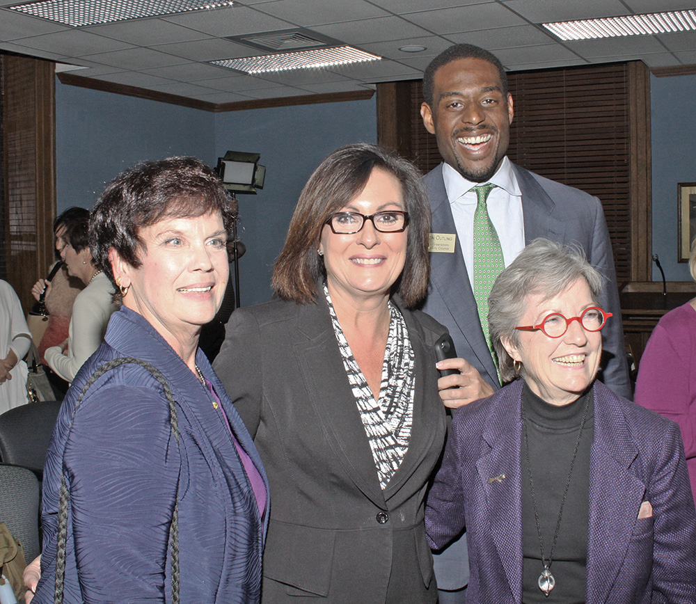 At-large Council member Marikay Abuzuaiter, Mayor Nancy Vaughan, District 3 Council member Justin Outling and District 4 Council member Nancy Hoffmann will be returning to council in 2016.  Photo by Charles Edgerton/Carolina Peacemaker