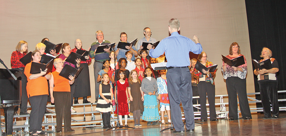 The Unitarian Universalist Chalice Choir and Triad Tapestry Children's Choir performed a medley of songs at a multicultural celebration held at Guilford College. Photo by Charles Edgerton / Carolina Peacemaker