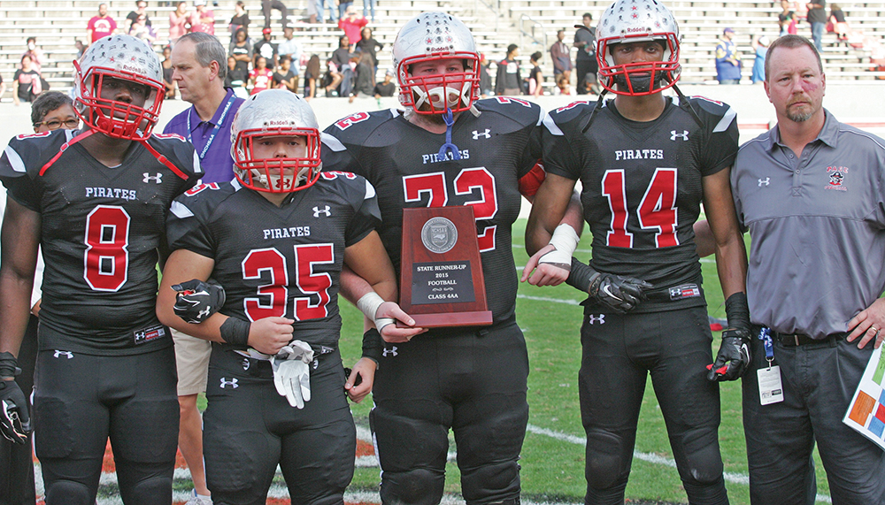 Page Pirate co-captains accept the Class 4-AA State Championship runner-up plaque.  (L-R) Madou Diarrassouba (8), Tony Duong (35), William Hardin (72), Doindre Overton (14) and head coach Kevin Gillespie. Photo by Joe Daniels/Carolina Peacemaker