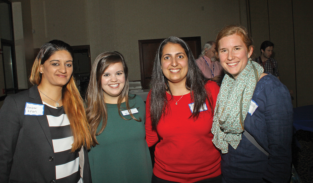 Muslim and Jewish students Amber Khan, Megan Sappenfield, Corie Hampton, and Hannah Henza enjoy the evening together.  Photo courtesy of Ivan Cutler