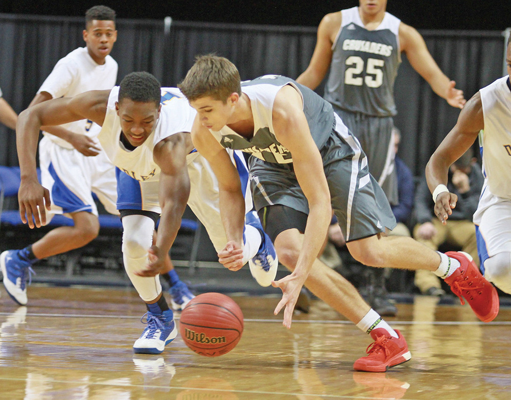 Dudley's Hendon Hooker and Trinity Christian's Joey Baker (right) scramble for a loose ball. Photo by Joe Daniels/Carolina Peacemaker