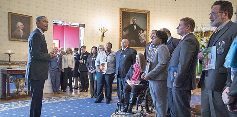 In the Blue Room of the White House, President Barack Obama talks with people whose lives have been impacted by gun violence, prior to announcing executive actions that the administration is taking to reduce gun violence, Jan. 5, 2016.  White House Photo by Pete Souza
