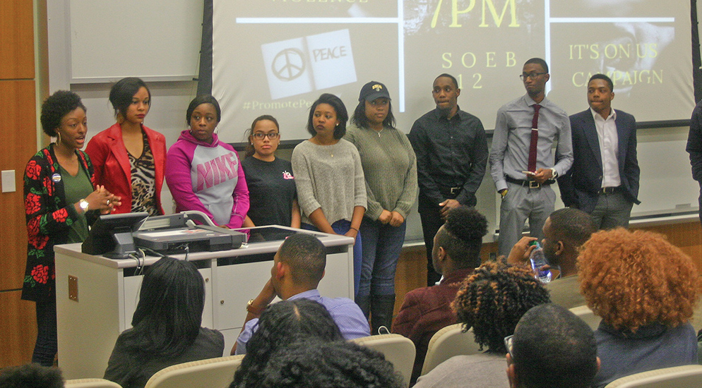 During a March 21 campus forum, UNCG members of  EBONY (Empowering and Building Opportunities in Yourself) and the UNCG chapter of Alpha Phi Alpha Fraternity, Inc.  apologize to the university's student body and faculty for a recent fighting incident that occurred at the organizations' campus Gym Jam dance. Photo by Yasmine Regester/Carolina Peacemaker