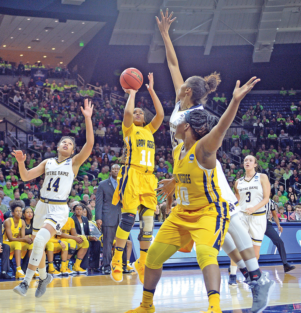 North Carolina A&T senior guard Adriana Nazario (11) contributed three points and three rebounds in the Aggies' first-round NCAA game against top-seed Notre Dame.  The Lady Aggies were defeated by the Fighting Irish, 95-61. Photo by Charles Watkins