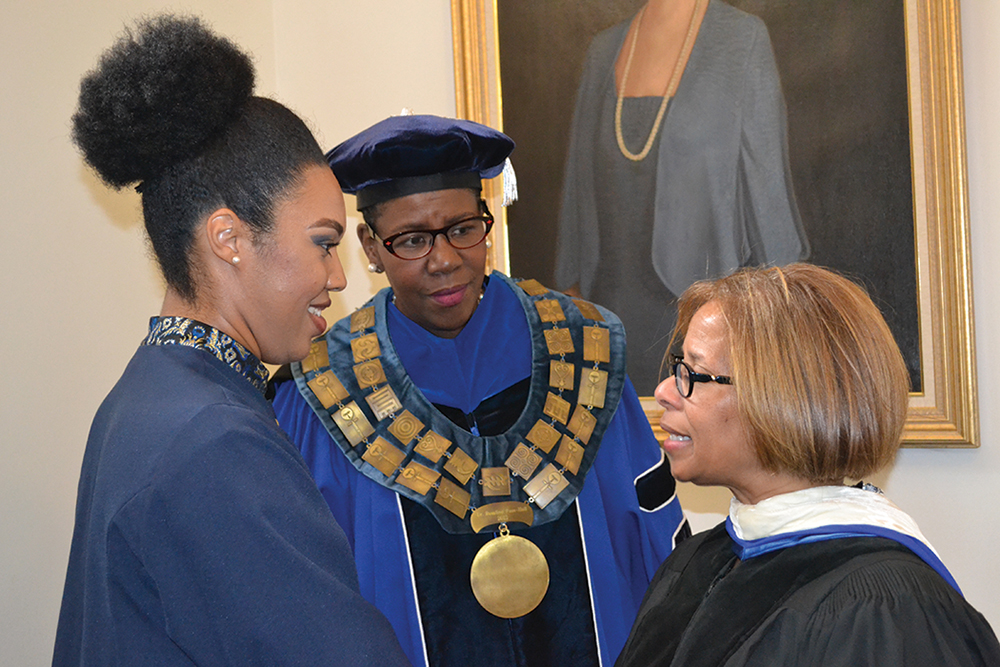 U.S. Assistant Attorney General Karol Mason greets Alexis Yvonne Monroe, a junior at Bennett College, after the Charter Day Convocation.  From left to right are:  Monroe, President Rosalind Fuse-Hall and Assistant Attorney General Mason. Photo  courtesy Bennett College