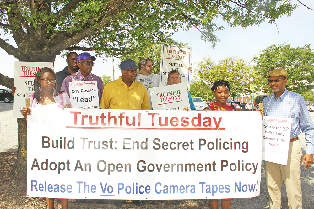 A coalition of community members march in downtown Greensboro on Tuesday, April 19, to support making police body camera footage public record.  Photo by Charles Edgerton/Carolina Peacemaker