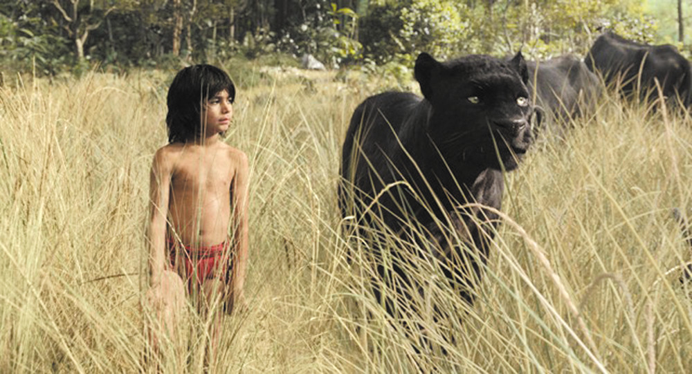 """Neel Sethi (left) stars in """"The Jungle Book."""" The movie features the voice talents of Giancarlo Esposito, Idris Elba, Bill Kingsley, Bill Murray, Scarlett Johansson and Lupita Nyong'o. Photo courtesy of Disney Films"""