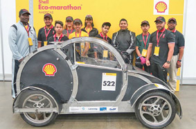 Rick Lewis, CTE Educator/Automotive Instructor with students David Alaya, Thui Romah, Deborah Vincent (club advisor), Daniel Romero, Joanna Ziegler, Y'China (G) H'dok, Henry Teodosio, Cesar Soto, Brayan Cruz and Donald Sweeper (DHS Engineering instructor) at the Shell competition.  Photo courtesy Ivan Cutler