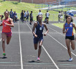 Tamara Clark (center), a High Point Central junior sprinter, swept the 100m and 200m dashes in 11.70 seconds and 23.99 seconds respectively. Clark was also a member of the Bison's winning 4x100m and 4x400m relay teams. Photo by Joe Daniels/Carolina Peacemaker