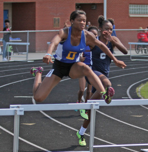 Jazmine Gooden, a Dudley senior, sweeps the 100m and 300m hurdles respectively with times of 14.29 seconds and 44.40 seconds. Gooden also won the long jump leaping 18-feet-4.75 inches. Photo by Joe Daniels/Carolina Peacemaker