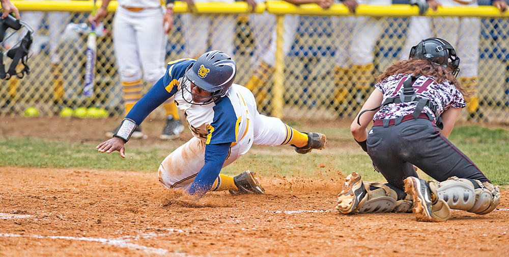 A&T first base player Kimberley Brunson, seen here avoiding the home plate tag against the N.C. Central Eagles, led the Aggies in hits, going 3-for-3 in Game 1 on Saturday, April 20. Photo by Kevin Dorsey
