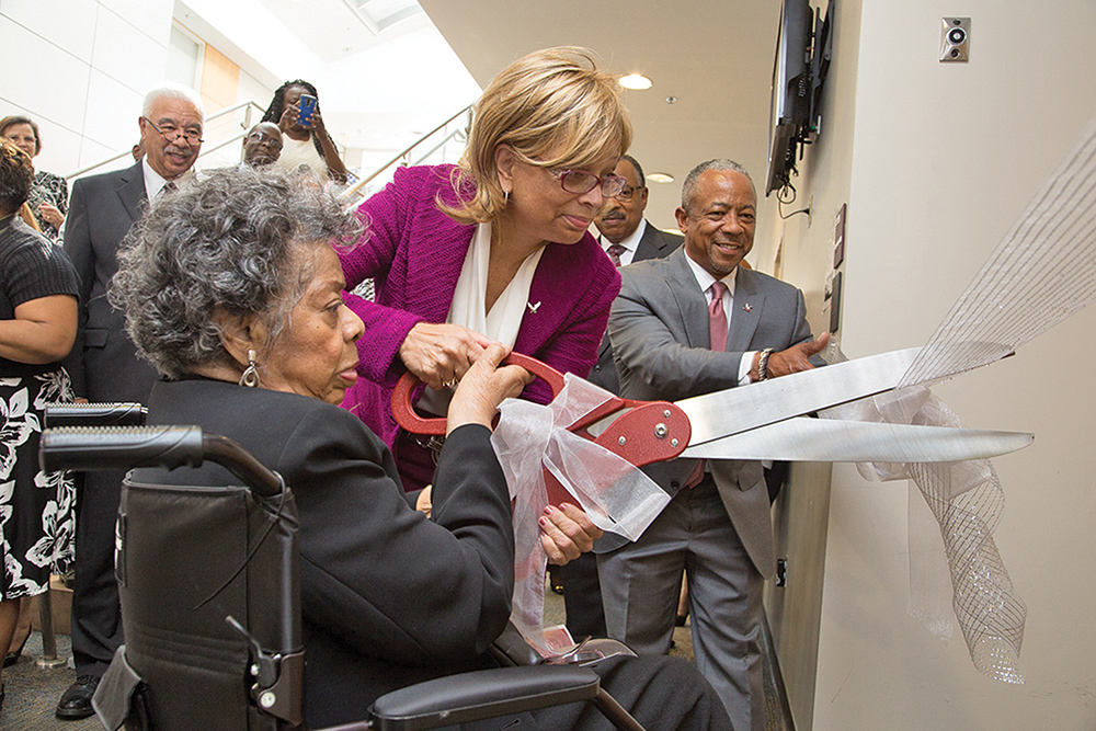 Greensboro resident and NCCU alumna Dr. Myrtle Sampson cuts ribbon with the university's Chancellor Deborah Sanders-White during the dedication of the Dr. Myrtle Boykin Sampson Teaching Hall on the N.C. Central University campus. Photo courtesy NCCU